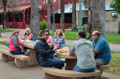 Shannon Hicks, center, chat with a group of concerned citizens over lunch in Library Park Wednesday. These folks, most of whom had never met face to face before, came together through Facebook groups Take Back Redding and Shasta Support Services to deliver a message to vagrants loitering nearby: This park is ours.