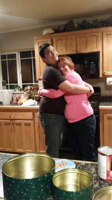 cindy valdez hugs son in kitchen