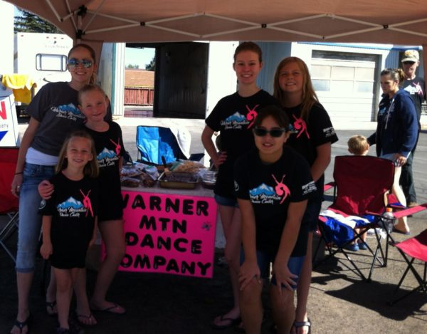 Girls from the Warner Mountain Dance Co. washed Burning Man autos on Labor Day.