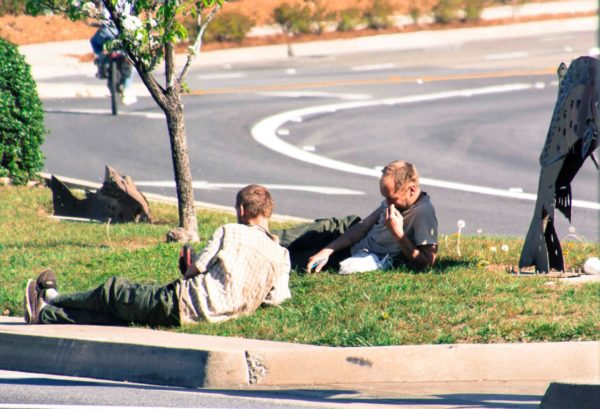 Two men resting near the un-Safeway. Photo courtesy of crumblingtownreddingca.wordpress.com, one of several local websites that document rising crime in Redding.