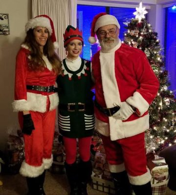 The Riggs family dresses in costumes to hand out candy to people who come to see the Riggs' lighted Christmas decorations.