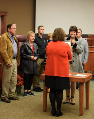City Clerk Pam Mize administers the oath of office to Julie Winter. Photos by Jon Lewis.