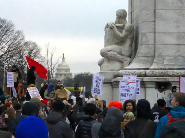 Mostly socialists gather for a pep talk before their march on the White House. That stone dude seems to have a good seat for viewing the inaugural ceremony.