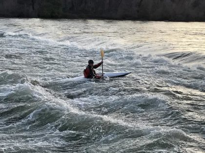 A lone kayaker rides the waves at the ACID dam near Caldwell Park in Redding. Photo by Jon Lewis.