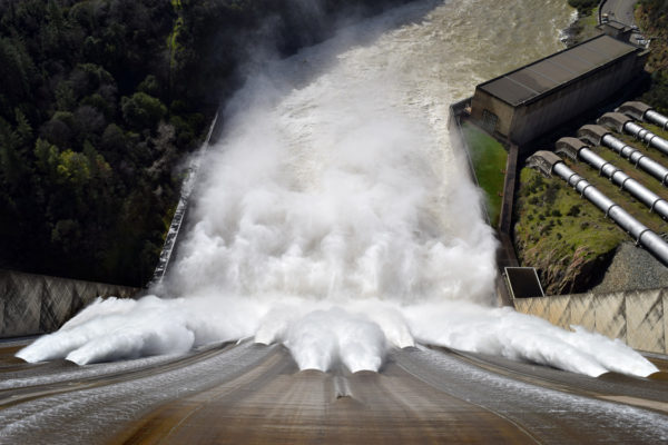 Water roars out of Shasta Dam at 70,000 cubic feet per second.
