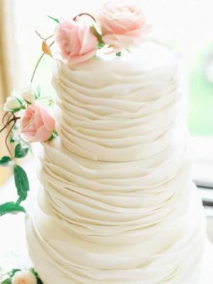 This ruffle wedding cake is what Joe Domke and Doni Chamberlain hoped to create for Erin and Aaron's wedding.
