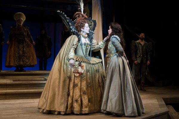 Ralph (Michael J. Hume, far left) and Ned Aleyne (far right) look on as Queen Elizabeth (Kate Mulligan) tells Viola (Jamie Ann Romero) it is time to say goodbye. Photo by Jenny Graham, Oregon Shakespeare Festival.