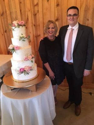 Doni and son Joe Domke breathe a sigh of relief that the cake is finished and it's still standing. Photo by Shelly Shively.