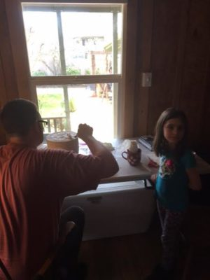 Joe Domke frosted cakes all day Friday as niece Lily (one of the flower girls) hung out and watched. (She wants to have a bakery when she grows up.) Photo by Shelly Shively.