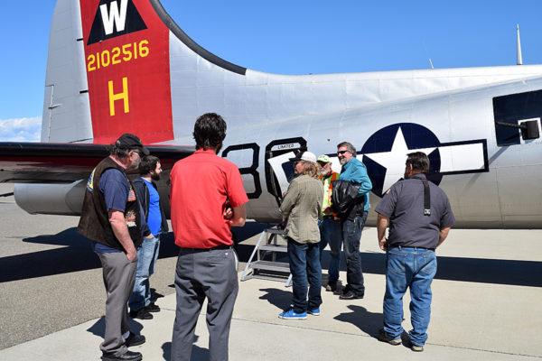 Cong. Doug LaMalfa (blue shirt, sunglasses) chats with passengers.