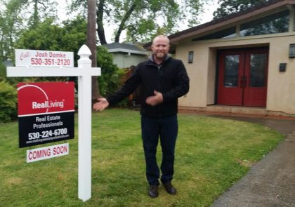 Realtor Joshua Domke, Doni's son, is squinting to keep the rain from his eyes.