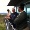 Blue Mountain Lookout worker Gary Neal, center, describes the lay of the land to Gary Sandusky, left, and Danelle Harrison.