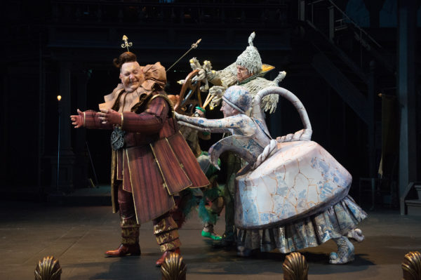 Cogsworth (Daniel T. Parker, left) is wound up by Mrs. Potts (Kate Mulligan, right) and Lumière (David Kelly). Photo by Jenny Graham, Oregon Shakespeare Festival.