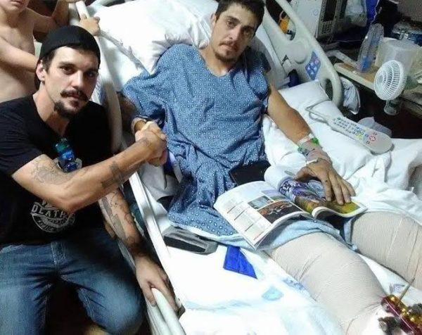 Bryant Krause and Ryan Christopher Rhodes, fellow bikers, visit in Rhodes hospital room. Photo courtesy Ryan Rhodes.