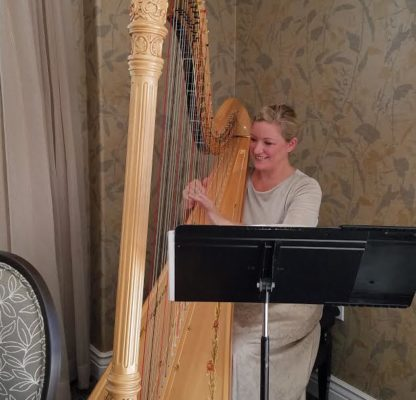 Redding harpist Candace LaVolsi played her harp in the Oakmont dining room.