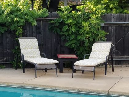 pair of metal and mesh chaise lounges with pads - 40 for the pair