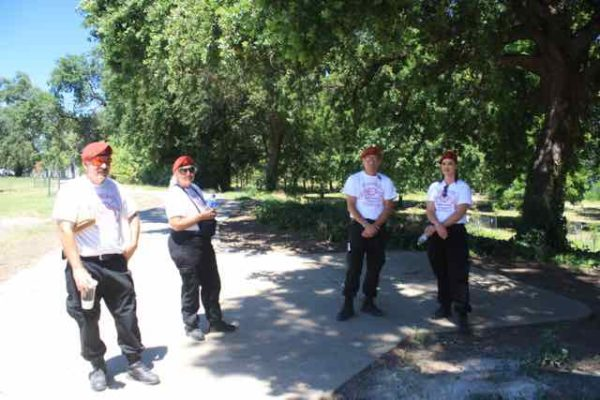 Redding Guardian Angels standing near the scene of the crime in Smile Place.