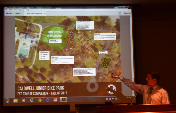 Nate Knudsen points out features of the Junior Bike Park.