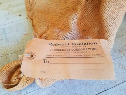 A tag and an old burlap bag that once held redwood shavings was found in the attic.