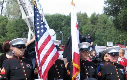 The color guard prepares for the formal presentation of colors