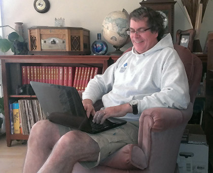 Photo of Robb Lightfoot on his laptop