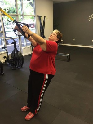 adrienne leaning back in work out april 2016