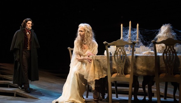 Pip (Benjamine Bonenfant) seeks answers from the heart-broken Miss Havisham (Judith-Marie Bergan). Photo by Jenny Graham, Oregon Shakespeare Festival.