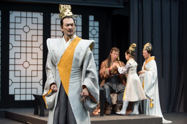 Leontes (Eric Steinberg) is tortured by jealous thoughts as his friend Polixenes (James Ryen), son Mamillius (Naomi Nelson) and wife Hermione (Amy Kim Waschke) play in the background. Photo by Jenny Graham, Oregon Shakespeare Festival.