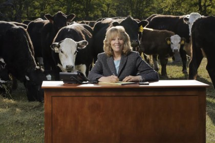 Mary Rickert, with some of her cows behind her.