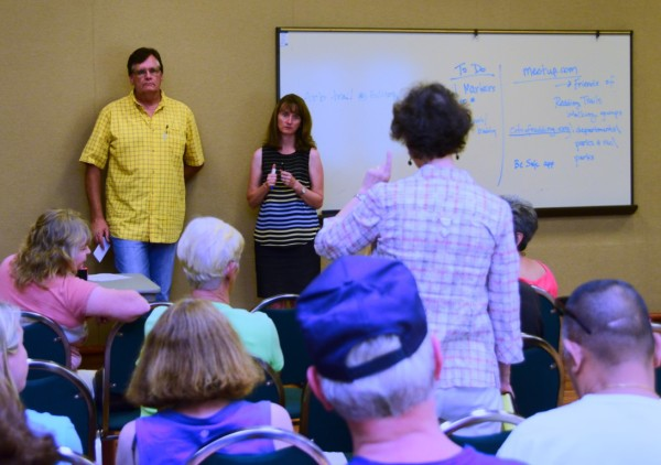 An audience member makes a point during a brainstorming session led by Anderson and Redding Community Services Director Kim Niemer.