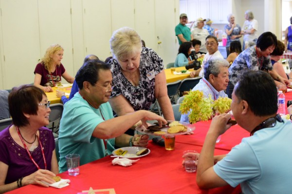 Ken Okabayashi of Elk Grove accepts a cookie from a volunteer during a lunch stop hosted by the Methodist church.