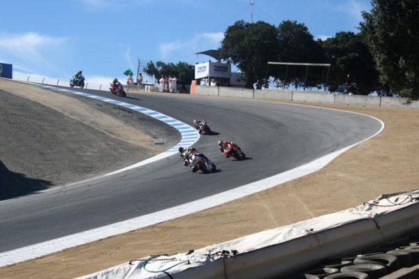 Nicky Hayden leads Davide Giuguiano through the corkscrew.