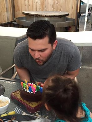 Matthew blows candles on his birthday cake