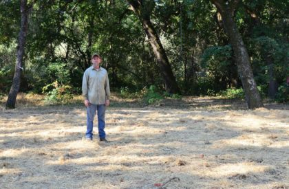 Property owner Frank Muegge stands in a clearing where he once lived in a two-bedroom home. He was run out by aggressive homeless campers on his property, who took over his vacant home until they burned it down. When others tried to live in the ruins, he had the foundation cleared.