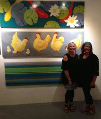 Shelly loves chickens so much she even painted a huge chicken piece for the O Street Gallery exhibit. (Doni, left, Shelly, right.)