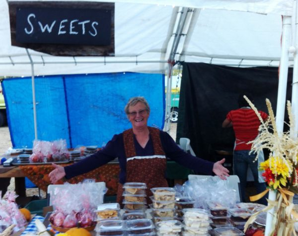 Judy Lynch happily sells homemade sweets—no judgment as to when purchased.