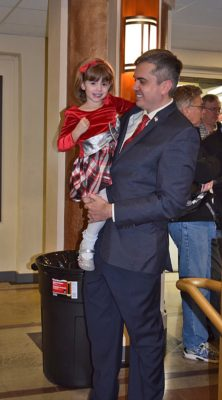 Councilman-elect Adam McElvain with his daughter, Pepper, at an earlier rally.