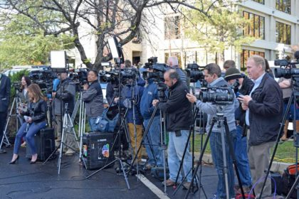 News media pack in tight during Wednesday's press conference. Photo by Jon Lewis