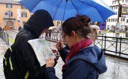 Navigators Joe and Marie consult their mapping devices in the Florence rain.