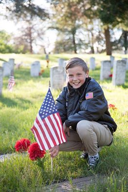 Preston Sharp, 11, has placed more than 15,000 flags and flowers on north state graves to other their service and sacrifice.