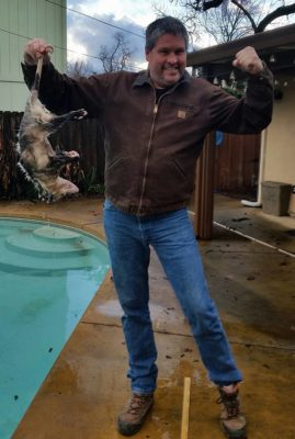 TJ Whitmore was Doni's hero when he fished this dead opossum from her swimming pool.