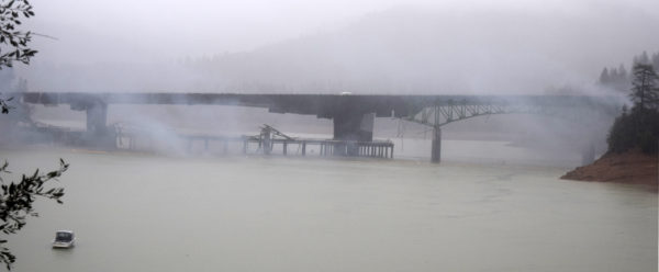 Smoke clears to reveal the stubborn southern span is still intact.