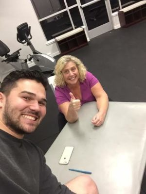Align owner and trainer, Matthew R. Lister, hams it up with Diane B. Hill, who's lost 100 pounds in a year and a half.