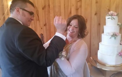 Joe gets some cuff-link assistance from his Aunt Shelly, mother of the groom.