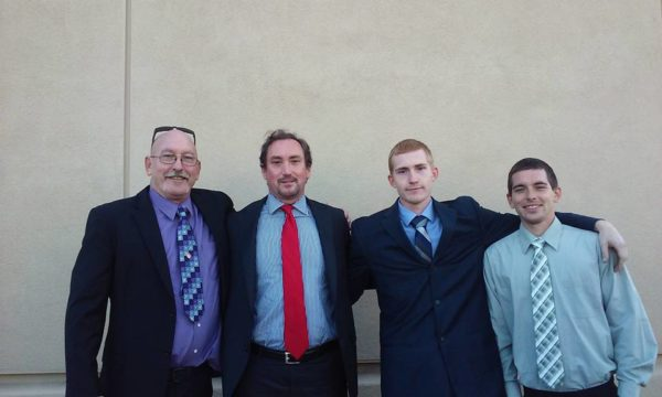 James Benno, left, with attorney Joseph Tully and sons Logan and Jacob Benno. Photo courtesy of James Benno.