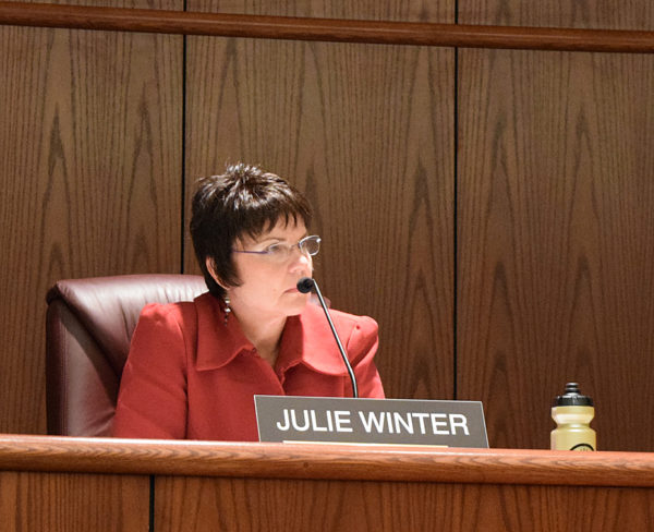 Councilwoman Julie Winter listens to testimony.