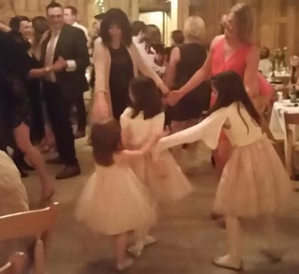 Son Joe dances with Aunt Bethany, while Aunt Saeri dances with cousin Brooke and her daughters, the flower girls.