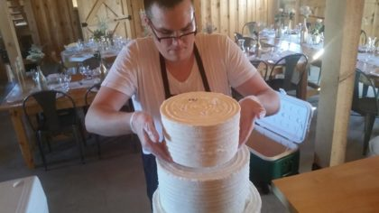 Joe had scored an area on the top of each cake as a guide upon which to gently lower each new layer.
