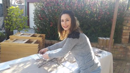 Katerina Domke decorates tables for the rehearsal dinner.