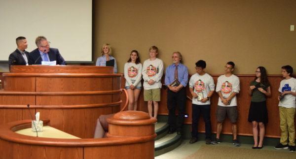 Mayor Brent Weaver, left, REU's Matt Madison and U Prep Regional Science Bowl winners.